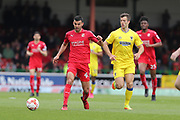 Swindon Town midfielder Conor Thomas (4) and AFC Wimbledon defender Jon Meades (3) during the EFL Sky Bet League 1 match between Swindon Town and AFC Wimbledon at the County Ground, Swindon, England on 14 April 2017. Photo by Stuart Butcher.