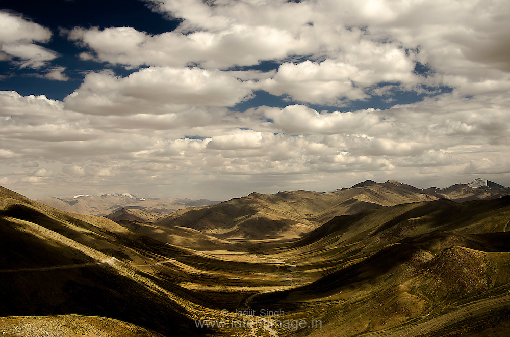 Light and Shadow. Beautiful formation of Clouds. A view from T Top, on the way to Leh.