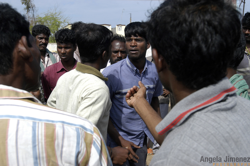 Prakash M., 20, center, one of 32 young men appointed by their village government to oversee the equitable distribution of saris and gas stoves donated by an NGO, argues with villagers in the fishing village of Perumalpettai in Tamil Nadu, India on January 20, 2005. The area was struck by the Indian Ocean Tsunami on December 26, 2004, killing 37 of the villagers and destroying nearly all of their fishing boats. Generated by an earthquake on the ocean floor, the tsunami devastated the fishing industry along the southeastern coast of India. after the area was struck by the Indian Ocean Tsunami on December 26, 2004, killing 37 of the villagers and destroying nearly all of their fishing boats. Generated by an earthquake on the ocean floor, the tsunami devastated the fishing industry along the southeastern coast of India.