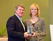 ACC Commissioner John D. Swofford presents former Wake Forest star Beth Davis Fagan with her Women's ACC Legends Award at the 2011 ACC Legends Banquette held at the Terrace Greensboro Coliseum Complex in Greensboro, North Carolina.  (Photo by Mark W. Sutton)