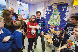 © Licensed to London News Pictures . 12/12/2014 . Sheffield , UK . EMBARGOED UNTIL 00:01 22 December 2014 . One of the children poses for a selfie with Nick Clegg after the recording . Special Christmas edition of radio show Call Clegg recorded at Sheffield Children's Hospital , with Deputy Prime Minister Nick Clegg taking questions from children on the ward , hosted by Nick Ferrari . Photo credit : Joel Goodman/LNP