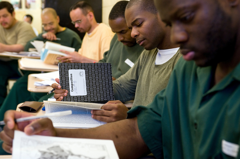 "Woodbourne Correctional Facility inmates and Bard College students during class..Story: The Bard Prison Initiative.Former inmate Carlos Rosario, 35-year-old husband and father of four, was released from Woodbourne Correctional Facility after serving more than 12 years for armed robbery. Rosado is one of the students participating in the Bard Prison Initiative, a privately-funded program that offers inmates at five New York State prisons the opportunity to work toward a college degree from Bard College. The program, which is the brainchild of alumnus Max Kenner, is competitive, accepting only 15 new students at each facility every other year. .Carlos Rosario received the Bachelor of Arts degree in social studies from the prestigious College Saturday, just a few days after his release. He had been working on it for the last six years. His senior thesis was titled ""The Diet of Punishment: Prison Food and Penal Practice in the Post-Rehabilitative Era,"".Rosado is credited with developing a garden in one of the few green spaces inside the otherwise cement-heavy prison. In the two years since the garden's foundation, it has provided some of the only access the prison's 800 inmates have to fresh vegetables and fruit...Rosario now works for a recycling company in Poughkeepsie, N.Y...Photo © Stefan Falke"