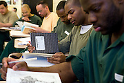 """Woodbourne Correctional Facility inmates and Bard College students during class..Story: The Bard Prison Initiative.Former inmate Carlos Rosario, 35-year-old husband and father of four, was released from Woodbourne Correctional Facility after serving more than 12 years for armed robbery. Rosado is one of the students participating in the Bard Prison Initiative, a privately-funded program that offers inmates at five New York State prisons the opportunity to work toward a college degree from Bard College. The program, which is the brainchild of alumnus Max Kenner, is competitive, accepting only 15 new students at each facility every other year. .Carlos Rosario received the Bachelor of Arts degree in social studies from the prestigious College Saturday, just a few days after his release. He had been working on it for the last six years. His senior thesis was titled """"The Diet of Punishment: Prison Food and Penal Practice in the Post-Rehabilitative Era,"""".Rosado is credited with developing a garden in one of the few green spaces inside the otherwise cement-heavy prison. In the two years since the garden's foundation, it has provided some of the only access the prison's 800 inmates have to fresh vegetables and fruit...Rosario now works for a recycling company in Poughkeepsie, N.Y...Photo © Stefan Falke"""