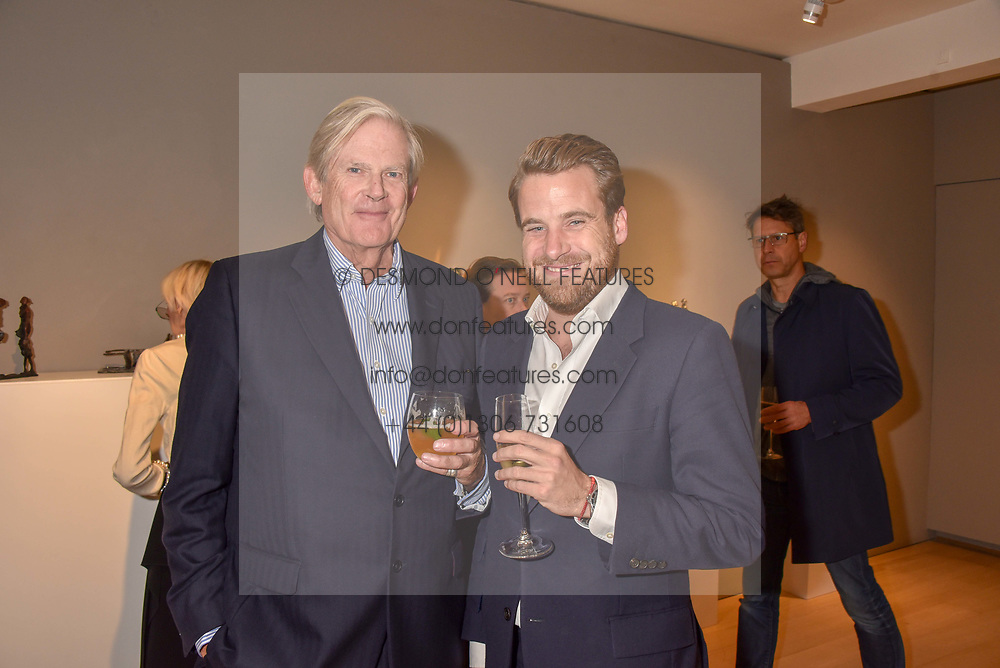 Left to right, John Anstruther-Gough-Calthorpe and Edward Lawson-Johnson at a private view of recent work by Georgiana Anstruther held at the Sladmore Gallery, 32 Bruton Place, London England. 08 November 2018. <br /> <br /> ***For fees please contact us prior to publication***