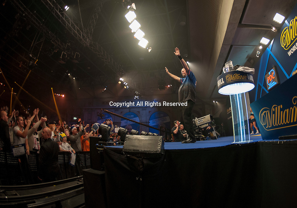 30.12.2014.  London, England.  William Hill PDC World Darts Championship.  Raymond van Barneveld (14) [NED] interacts with the crowd before his game with Adrian Lewis (3) [ENG].