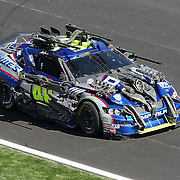 """Transformers rece cars from the movie """"Transformers: Dark of the Moon"""" participate in the Daytona 500 Sprint Cup race at Daytona International Speedway on February 20, 2011 in Daytona Beach, Florida. (AP Photo/Alex Menendez)"""