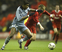 Photo. Aidan Ellis.<br />Liverpool v Marseille.<br />UEFA Cup 4th Round 1st leg.<br />11/03/2004.<br />Liverpool's Michael Owen battles with  Marseille's Habib Beye