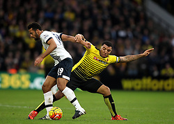 Troy Deeney of Watford tries to tackle Mousa Dembele of Tottenham Hotspur - Mandatory byline: Robbie Stephenson/JMP - 07966 386802 - 28/12/2015 - FOOTBALL - Vicarage Road - Watford, England - Watford v Tottenham Hotspur - Barclays Premier League
