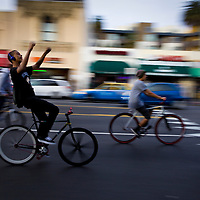 A group of cyclists ride down Hollywood Boulevard.