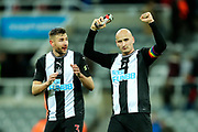 Jonjo Shelvey (#8) of Newcastle United celebrates Newcastle United's 2-1 victory as a bloodied Paul Dummett (#3) of Newcastle United looks on following the Premier League match between Newcastle United and Southampton at St. James's Park, Newcastle, England on 8 December 2019.