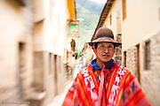 A man in traditional poncho in Ollantaytambo, Peru.