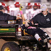 Thomas Wells | Buy at PHOTOS.DJOURNAL.COM<br /> Itawamba's David Lacey signals to the fans as he is carted off the field with a broken arm in the fourth quarter of their game against Corinth.