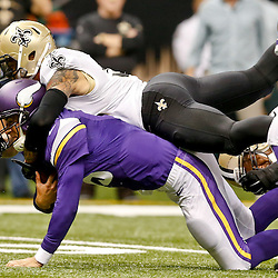 Sep 21, 2014; New Orleans, LA, USA; New Orleans Saints strong safety Kenny Vaccaro (32) tackles Minnesota Vikings quarterback Matt Cassel (16) during the second quarter of a game at Mercedes-Benz Superdome. Mandatory Credit: Derick E. Hingle-USA TODAY Sports