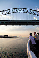 Touring the Willamette River by small ship. Views of the Fremont Bridge from the river