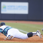 UNCW's Corey Dick misses a line drive as UNCW's Robbie Thorburn covers the ball Sunday February 22, 2015 during the Hughes Brothers Challenge at Brooks Field. (Jason A. Frizzelle)