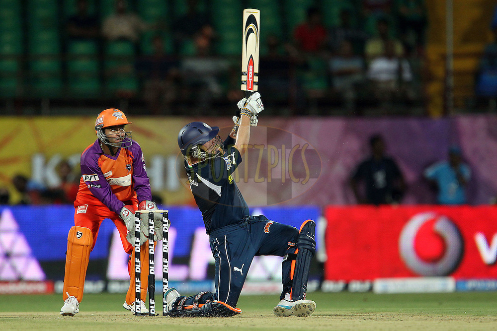 Cameron White launches a six during match 32 of the Indian Premier League ( IPL ) Season 4 between the Kochi Tuskers Kerala and the Deccan Chargers held at the Kallor Jawaharlal Nehru International Stadium in Kochi, Kerala  India on the 27th April 2011..Photo by Ron Gaunt/BCCI/SPORTZPICS