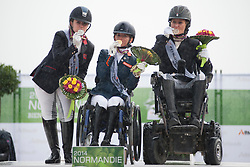 From left to right:<br /> Natasha Baker - Silver;  Rixt van der Horst - Gold;  Lauren Barwick - Bronze.  Podium for  Grade II Para-dressage Individual Test at the 2014 World Equestrian Games, Caen, Normandy, France..