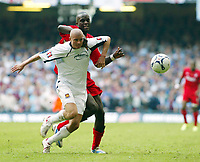 Photo: Chris Ratcliffe.<br />Liverpool v West Ham United. The FA Cup Final. 13/05/2006.<br />Paul Konchesky (L) of West Ham tussles with Mohamed Sissoko of Liverpool.