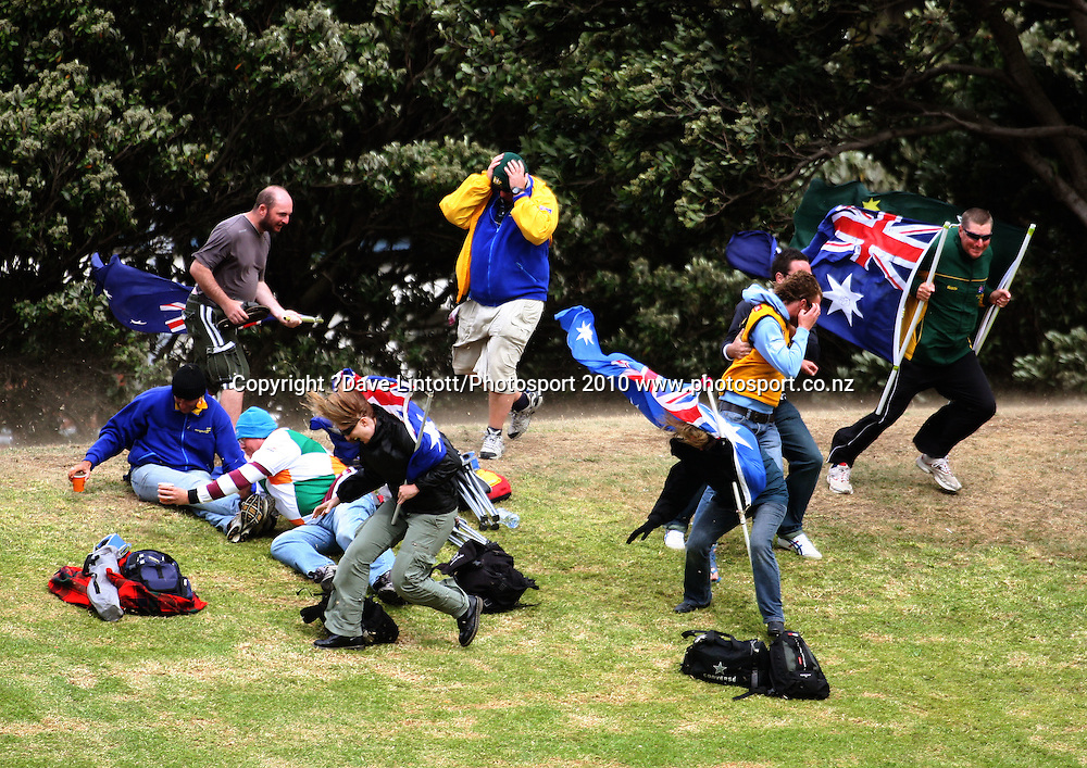 Australian fans are buffeted by the wind.<br /> 1st cricket test match - New Zealand Black Caps v Australia, day four at the Basin Reserve, Wellington. Monday, 21 March 2010. Photo: Dave Lintott/PHOTOSPORT