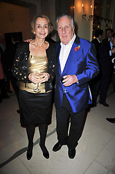 FREDERICK & SANDY FORSYTH at a party to celebrate the publiction of 'No Invitation Required' by Annabel Goldsmith, held at Claridge's, Brook Street, London on 11th November 2009.