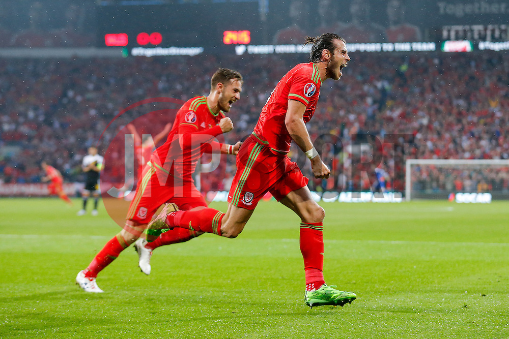 Gareth Bale of Wales (Real Madrid) celebrates scoring a goal to make it 1-0 - Photo mandatory by-line: Rogan Thomson/JMP - 07966 386802 - 12/06/2015 - SPORT - FOOTBALL - Cardiff, Wales - Cardiff City Stadium - Wales v Belgium - EURO 2016 Qualifier.