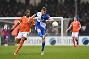 Alfie Kilgour (15) of Bristol Rovers clears the ball away from Armand Gnanduillet (21) of Blackpool during the EFL Sky Bet League 1 match between Bristol Rovers and Blackpool at the Memorial Stadium, Bristol, England on 15 February 2020.