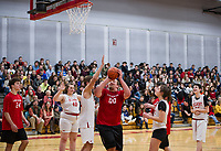 Sean Martston looks for a shot to the basket during the Unified Basketball game at Belmont High School on Monday afternoon. (l-r) Cole Roy-24, Elissa Pinard-40, Kaden Jewell-31, Sean Marston-00, Cameron Hayes-61, Kelley Allen-3 and Christian Sanborn-25.    (Karen Bobotas/for the Laconia Daily Sun)