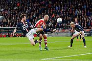 09-04-2016 VOETBAL:PSV:WILLEM II:EINDHOVEN<br /> Erik Falkenburg van Willem II kopt de bal op het doel en Jorrit Hendrix van PSV is net te laat en Nick van der Velden van Willem II <br /> Foto: Geert van Erven