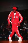B-Boy in red tracksuit dancing at UK B-Boy Championships 2005.