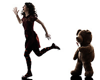 one  strange young woman killer teddy bear in silhouette white background