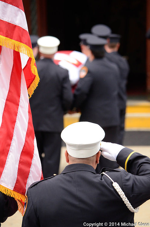Staten Island, New York - July 10: 1000s of Firefighters attend the Funeral of Lt Gordon M. Ambelas L119 at Saint Clares Church on July 10, 2014 in New York, New York. Photo Credit: Michael Glenn / Glenn Images