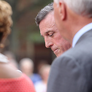 Delaware Governor John Carney delivers remarks as Mayor Mike Purzycki and City Council President Hanifa Shabazz, D.H.L. (RIGHT) listen during the changing of the guard as live nation takes over The Queen Theater Wednesday, June 14, 2017 on Market Street in downtown Wilmington Delaware.