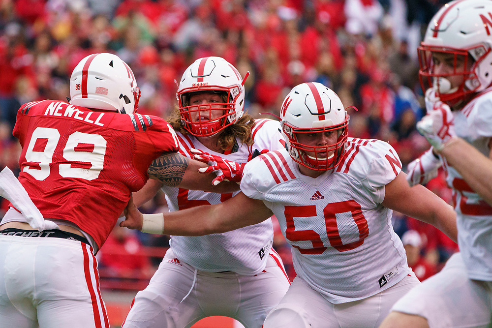 Will Farniok #68 and John Raridon #50 blocks Peyton Newell #99 during Nebraska's annual Spring Game at Memorial Stadium in Lincoln, Neb., on April 21, 2018. © Aaron Babcock