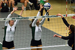 28 October 2016:  Maisy Bowden and Rachel Burkman during an NCAA womens division 3 Volleyball match between the DePauw Tigers and the Illinois Wesleyan Titans in Shirk Center, Bloomington IL