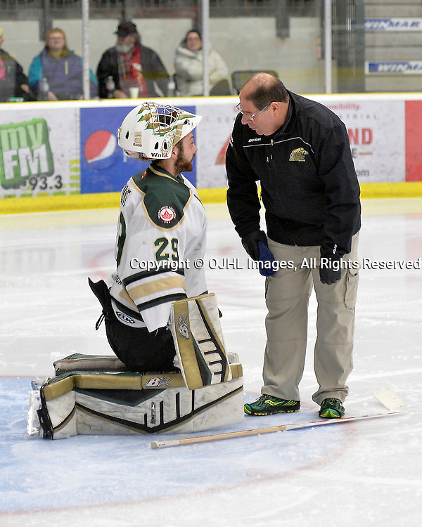 COBOURG, ON  - MAR 4,  2017: Ontario Junior Hockey League, playoff game between the Cobourg Cougars and the Kingston Voyageurs. Cobourg Trainer Joe Aiello checks on goaltender Stefano Durante #29 of the Cobourg Cougars during the third period.  <br /> (Photo by Shawn Muir / OJHL Images)