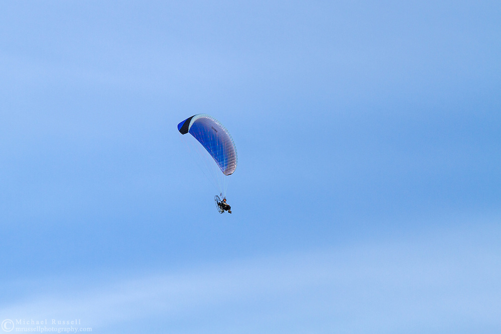 A parasailer flying over Blackie Spit in Cresent Beach, British Columbia, Canada