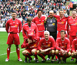 LIVERPOOL, ENGLAND - SUNDAY MARCH 27th 2005: Liverpool Legends line-up for a team photo before taking on a Celebrity XI during the Tsunami Soccer Aid match at Anfield. (Pic by David Rawcliffe/Propaganda)..Back row L-R: John Aldridge, Kenny Dalglish, Gary Ablett, Bruce Grobbelaar, Alan Hansen, Jan Mølby, Phil Thompson, Neil Ruddock, Ronnie Whelan, John Barnes, Robbie Fowler, Ian Rush, Sander Westerveld. Front row L-R: Jason McAteer, David Johnson, Gary Gillespie, Alan Kennedy, Paul Walsh, Phil Neal, Alan Farley and Paul Dalglish.