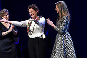Koningin Máxima bij de Prins Bernhard Cultuurfonds Prijs 2015  in Muziekgebouw aan 't IJ in  Amsterdam. Het Cultuurfonds kent deze oeuvreprijs jaarlijks toe aan een persoon of instelling met een grote staat van dienst op gebied van cultuur of natuur in Nederland. Aan de prijs is een bedrag van 150.000 euro verbonden. <br /> <br /> Queen Máxima at the Prince Bernhard Culture Price in 2015 in the Muziekgebouw aan 't IJ in Amsterdam. The Culture Fund knows this lifetime achievement award presented annually to a person or organization with a strong track record in terms of culture and nature in the Netherlands. The prize is worth 150,000 euros.<br /> <br /> Op de foto / On the photo:  Koningin Maxima  reikt samen met Adriana Esmeijer de Prins Bernhard Cultuurfonds Prijs 2015 uit aan architect Francine Houben<br /> <br /> Queen Maxima and Adriana Esmeijer give the Prince Bernhard Culture Price in 2015 to the architect Francine Houben
