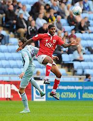 Bristol City's Mark Little battles for the high ball with Coventry City's Adam Barton  - Photo mandatory by-line: Joe Meredith/JMP - Mobile: 07966 386802 - 18/10/2014 - SPORT - Football - Coventry - Ricoh Arena - Bristol City v Coventry City - Sky Bet League One
