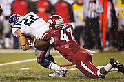 FAYETTEVILLE, AR - NOVEMBER 22:  Martrell Spaight #47 of the Arkansas Razorbacks tackles Jordan Wilkins #22 of the Ole Miss Rebels at Razorback Stadium on November 22, 2014 in Fayetteville, Arkansas.  The Razorbacks defeated the Rebels 30-0.  (Photo by Wesley Hitt/Getty Images) *** Local Caption *** Martrell Spaight; Jordan Wilkins
