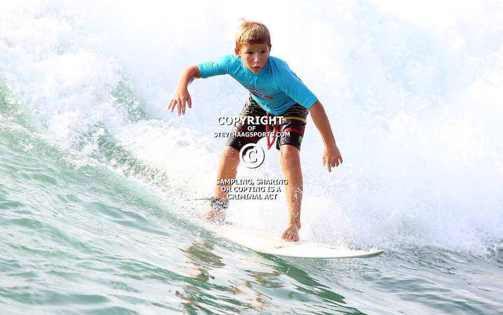 Fox Surfing North Beach Durban KZN,South Africa. January 20th 2016 (Photo by Steve Haag)<br /> <br /> images for social media must have consent from Steve Haag