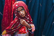 A girl belonging to the Maldhari community posing for a picture at a wedding.