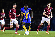 Shrewsbury Town midfielder Abu Ogogo (8) looks to release the ball during the EFL Sky Bet League 1 match between Northampton Town and Shrewsbury Town at Sixfields Stadium, Northampton, England on 20 March 2018. Picture by Dennis Goodwin.