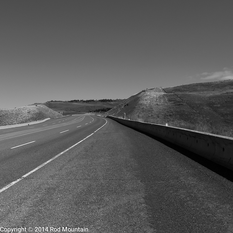 Highway 97C between Merritt and Kelowna midday, momentarily void of traffic.