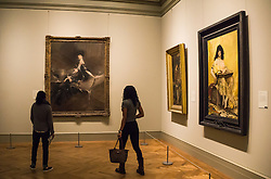 two women looking at paintings in a gallery at The Metropolitan Museum of Art in New York City