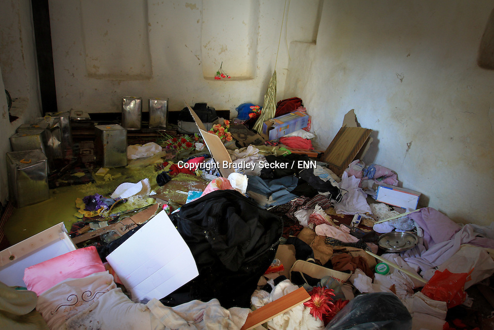 The destroyed contents of a home after a raid by the Syrian military in Al Janoudiyah, Syria