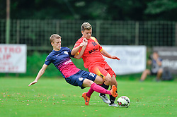 Nika Nemec of ZNK Pomurje vs. Alexandra Lunca of Olimpia Cluj Napoca during the UEFA Women's Champions League Qualifying Match between ZNK Teleing Pomurje (SLO) and Olimpia Cluj (ROU) at Sportni Park on August 16, 2015 in Beltinci, Slovenia. Photo by Mario Horvat / Sportida