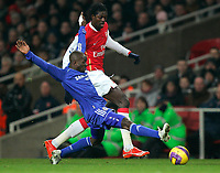 Photo: Tom Dulat/Sportsbeat Images.<br /> <br /> Arsenal v Chelsea. The FA Barclays Premiership. 16/12/2007.<br /> <br /> Chelsea's Claude Makalele reach for the ball. Emmanuel Adebayor of Arsenal is behind him.