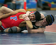 John Choorman of Fairport, left,  competes against Ryan MacDonell of Midlakes in the 120-pound weight class during a match at Fairport High School on Saturday, December 13, 2014.