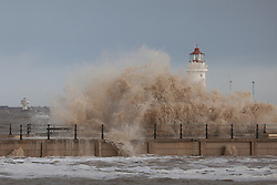 © Licensed to London News Pictures. 03/01/2014.New Brighton, UK . Waves engulf the lighthouse at New Brighton as the high tide arrives. Photo credit : Andrew Dawson/LNP